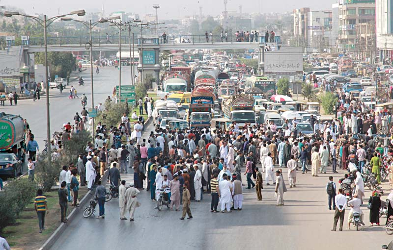 protest clogs traffic on korangi road