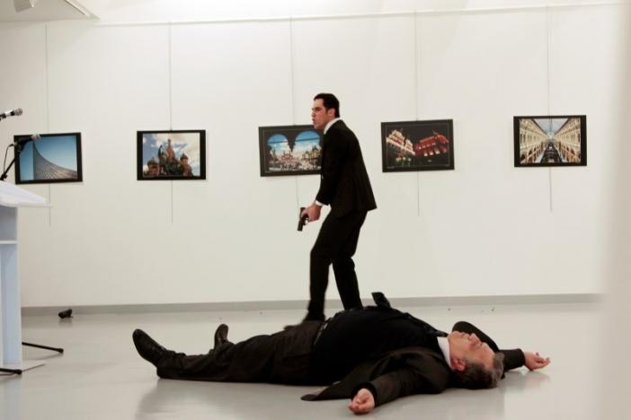 Russian Ambassador to Turkey Andrei Karlov lies on the ground after he was shot by Mevlut Mert Altintas at an art gallery in Ankara, Turkey. Hasim Kilic/Hurriyet via REUTERS