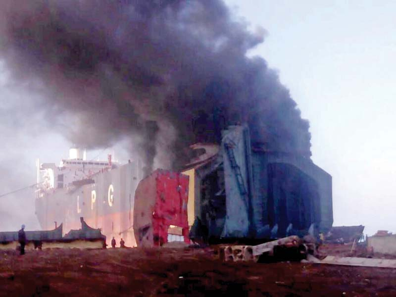 A fire engulfs a ship which caught fire at the Gadani Ship breaking Yard. PHOTO: PPI