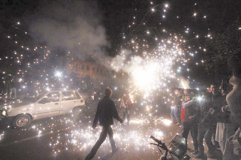 people set off firecrackers to celebrate new year in lahore photo abid nawaz express