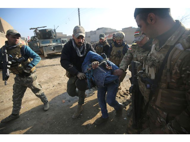 iraqi forces detain a man suspected of belonging to the islamic state is group in the al intisar area in eastern mosul after recapturing it in an ongoing military operation against the militants on january 1 2017 photo afp
