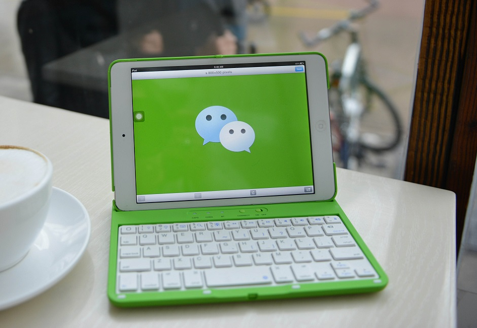 With its newest feature, WeChat wants you never to download or install another app. PHOTO: AFP