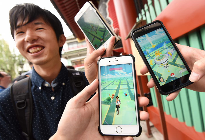 People will not be allowed to play augmented-reality games until it completes a review of potential security risks. PHOTO: AFP