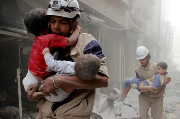 members of the syria civil defence rescueing children photo reuters
