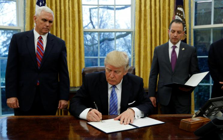trump signs order withdrawing us from trans pacific trade deal