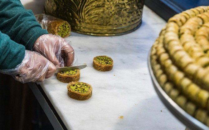 exiled-pastry-chef-tamem-al-sakka-is-seen-working-in-his-pastry-shop-quot-konditorei-damaskus-quot-in-the-neukoeln-neighbourhood-of-berlin-on-january-12-2017-photo-afp