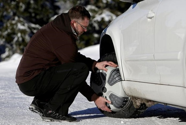 now fitting snow chains to your car is as simple as press of a button