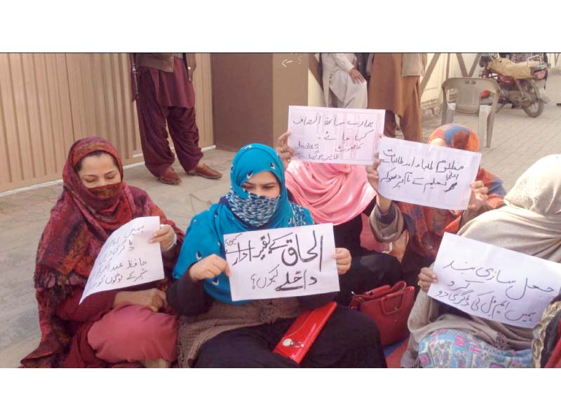female students stage a sit in photo express