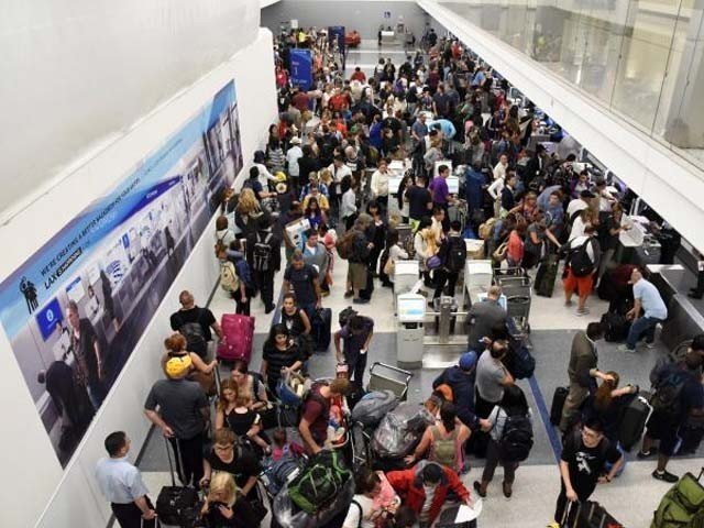 delayed passengers inside terminal 7 at los angeles international airport line up to go through tsa security check following a false alarm event in los angeles california us august 28 2016 photo reuters