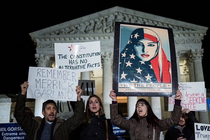Protestors gather outside of the Supreme Court, January 31, 2017 in Washington, DC. PHOTO: AFP