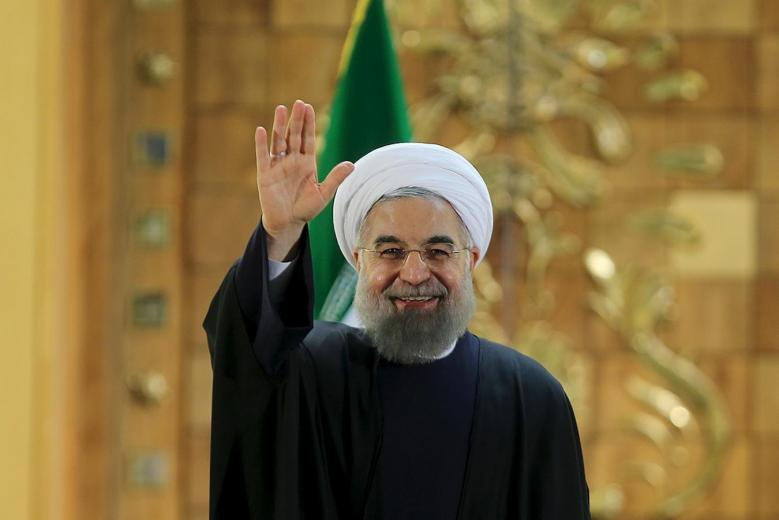 Iranian President Hassan Rouhani waves during a news conference in Tehran, Iran . PHOTO: REUTERS