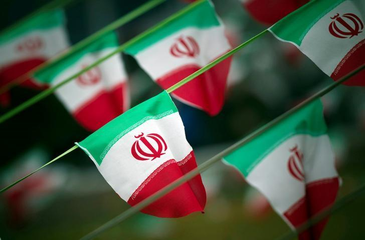 Iran's national flags are seen on a square in Tehran, Iran February 10, 2012. PHOTO: REUTERS