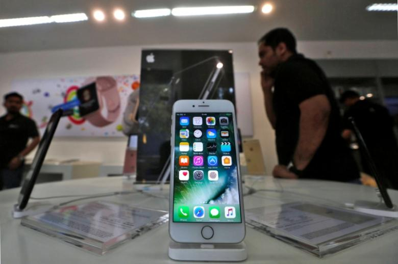 an iphone is seen on display at a kiosk at an apple reseller store in mumbai india photo reuters