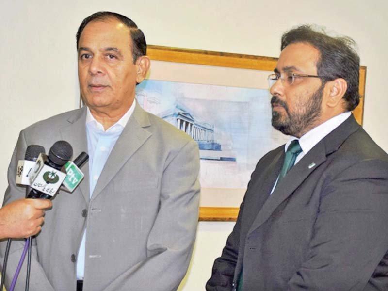 nab chairman qamar zaman chaudhry talks to the media photo online