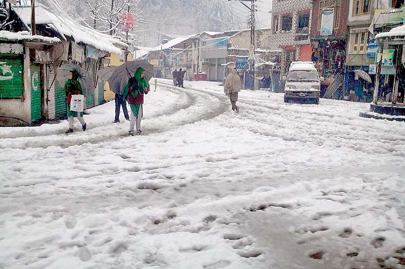 Snow covers a road in the Alpuri after the first snowfall of the season. PHOTO: INP