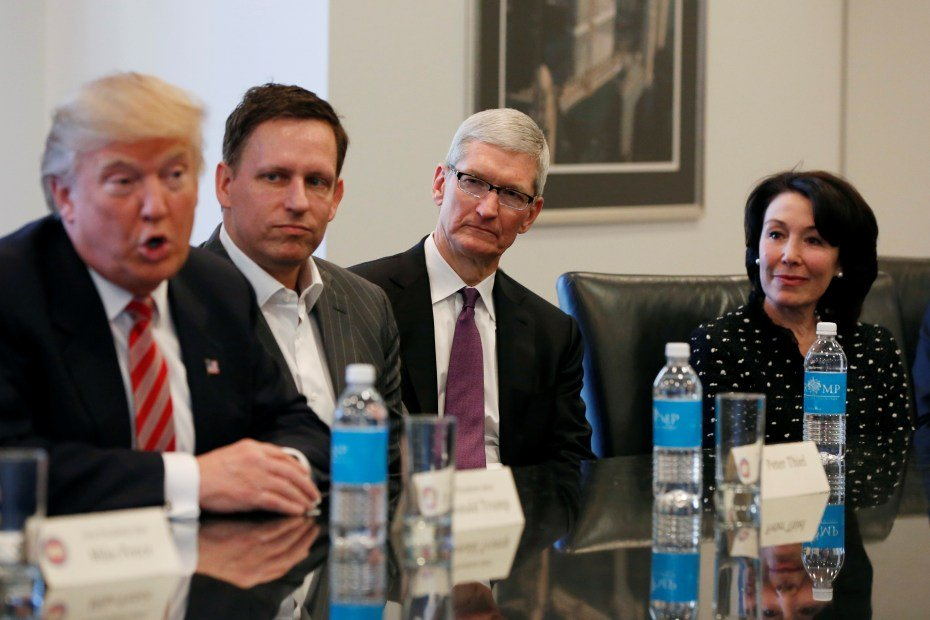 us president elect donald trump speaks as paypal co founder and facebook board member peter thiel apple inc ceo tim cook and oracle ceo safra catz look on during a meeting with technology leaders at trump tower in new york photo reuters