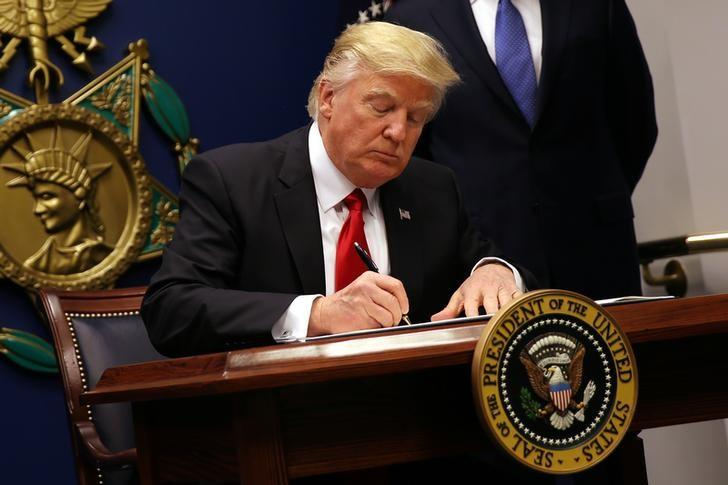 us president donald trump signs an executive order to impose tighter vetting of travelers entering the united states at the pentagon in washington u s photo reuters