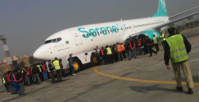 the serene air jet is being pulled by the tug machine at islamabad airport photo inp