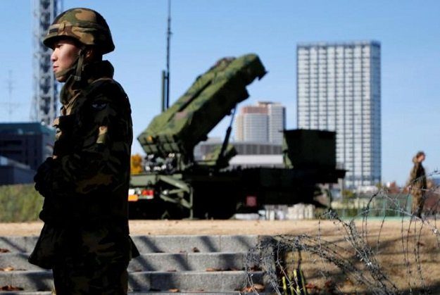 members of the japan self defence forces stand guard near patriot advanced capability 3 pac 3 land to air missiles deployed at the defense ministry in tokyo japan december 7 2012 photo reuters