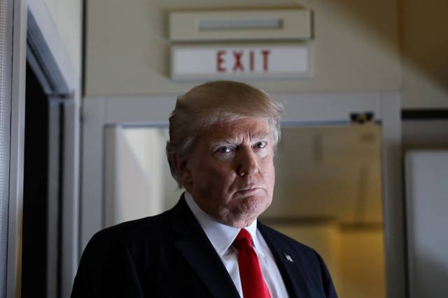 US President Donald Trump pauses as he talks to journalists who are members of the White house travel pool on board Air Force One during his flight to Palm Beach, Florida while over South Carolina, US, February 3, 2017. PHOTO: REUTERS
