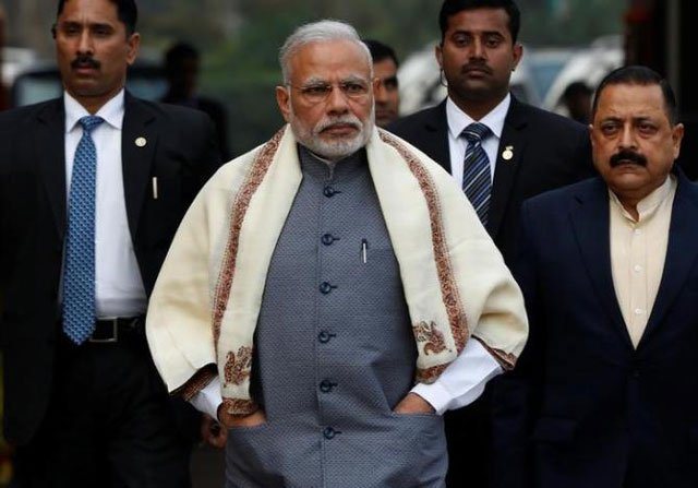 prime minister narendra modi walks to speak with the media as he arrives at the parliament house to attend the first day of the budget session in new delhi january 31 2017 photo reuters