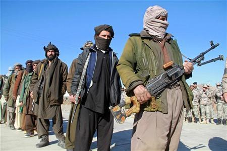 taliban militants hand over their weapons after joining the afghan government 039 s reconciliation and reintegration programme in herat on january 30 2012 reuters mohammad shoiab