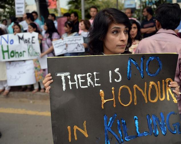 pakistani human rights activists hold placards during a protest in islamabad against 039 honour killings 039 on may 29 2014 photo afp