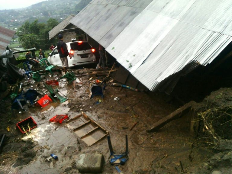 villagers attempt to salvage their belongings from a house damaged in a landslide in kintamani bali province photo afp
