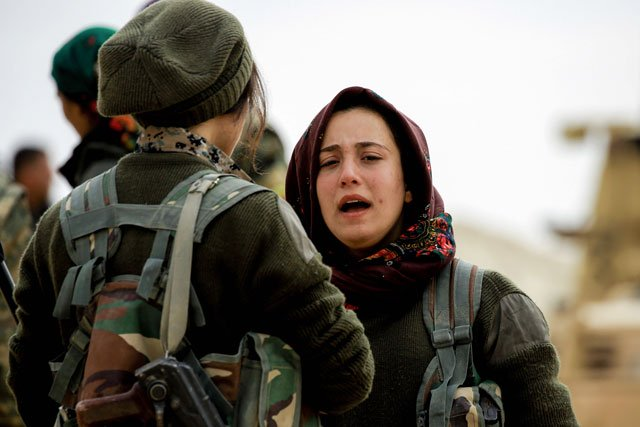batul a 21 year old female arab fighter among the syrian democratic forces made up of us backed kurdish and arab fighters talks with another fighter near the village of al torshan 20 km on the outskirts of raqa on february 6 2017 photo afp
