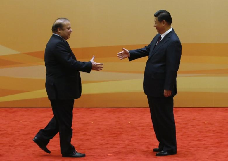 china 039 s president xi jinping r shakes hands with pakistan 039 s prime minister nawaz sharif at their family photo session prior to the dialogue on strengthening connectivity partnership at the diaoyutai state guesthouse in beijing november 8 2014 photo reuters