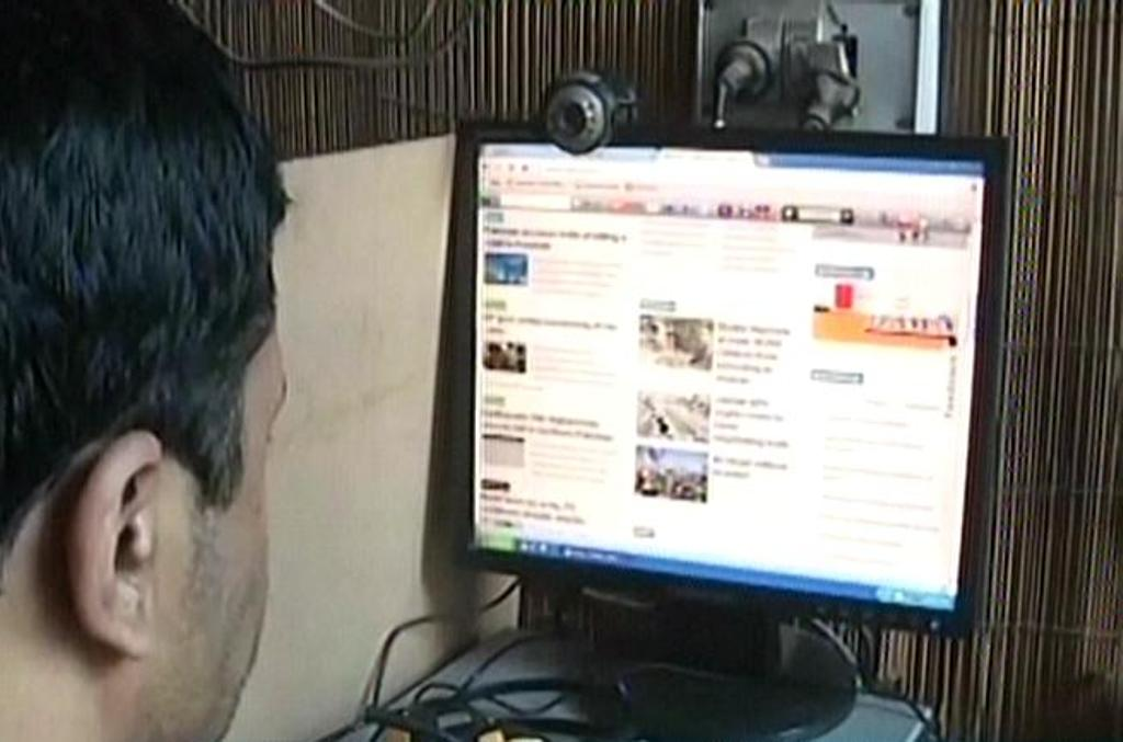 screengrab of internet cafe user browsing the internet photo file