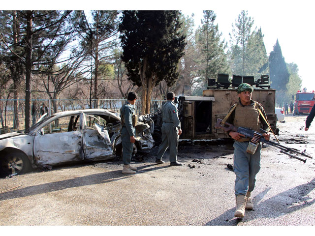 afghan policemen inspect a damaged army vehicle after a suicide attack in lashkar gah helmand province afghanistan february 11 2017 photo reuters