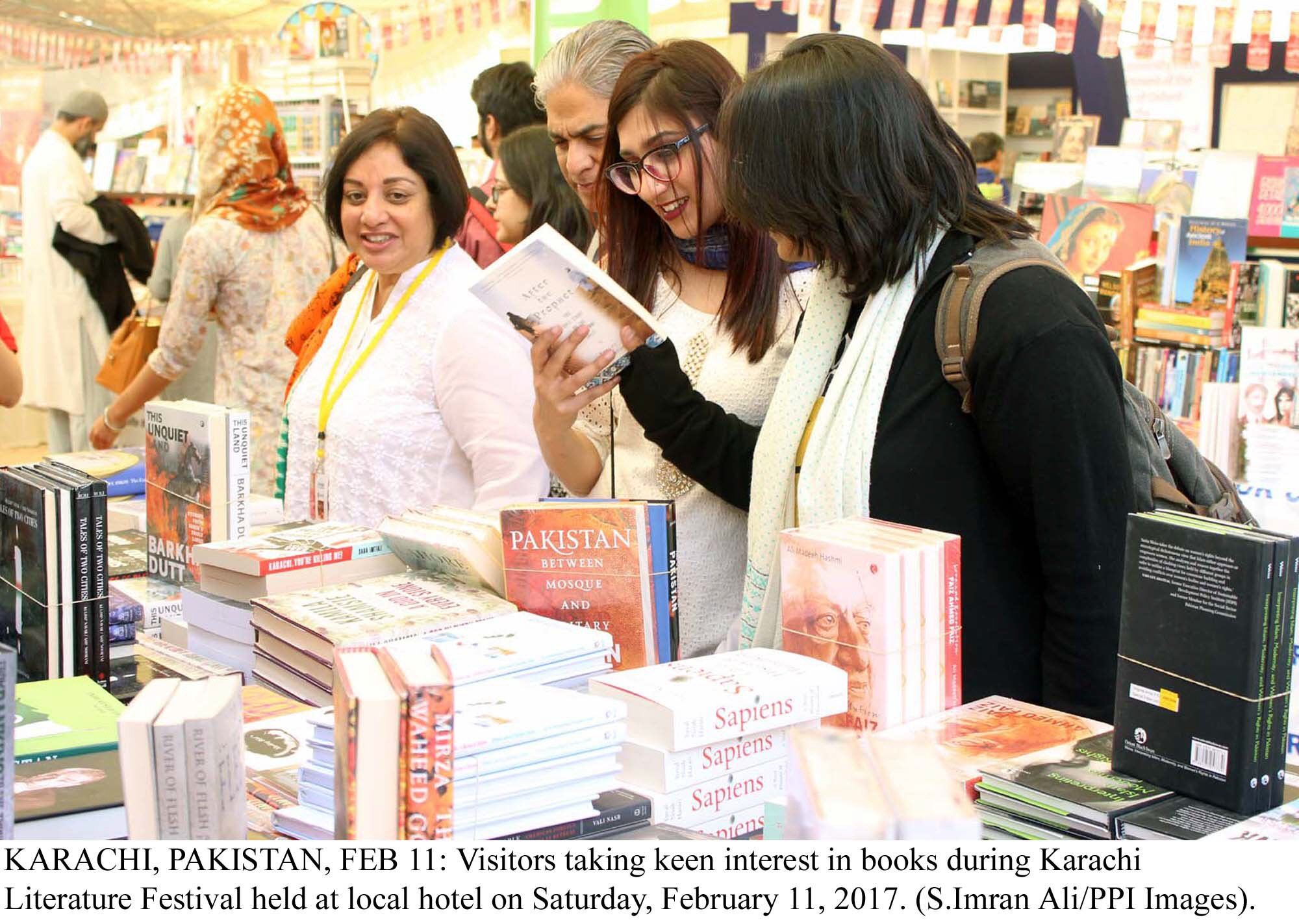visitors taking keen interest in books during karachi literature festival photo ppi