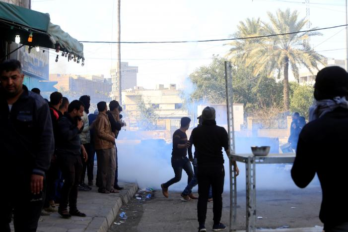 iraqi security forces fire tear gas after supporters of iraqi shi 039 ite cleric moqtada al sadr tried to approach the heavily fortified green zone during a protest at tahrir square in baghdad iraq february 11 2017 photo reuters