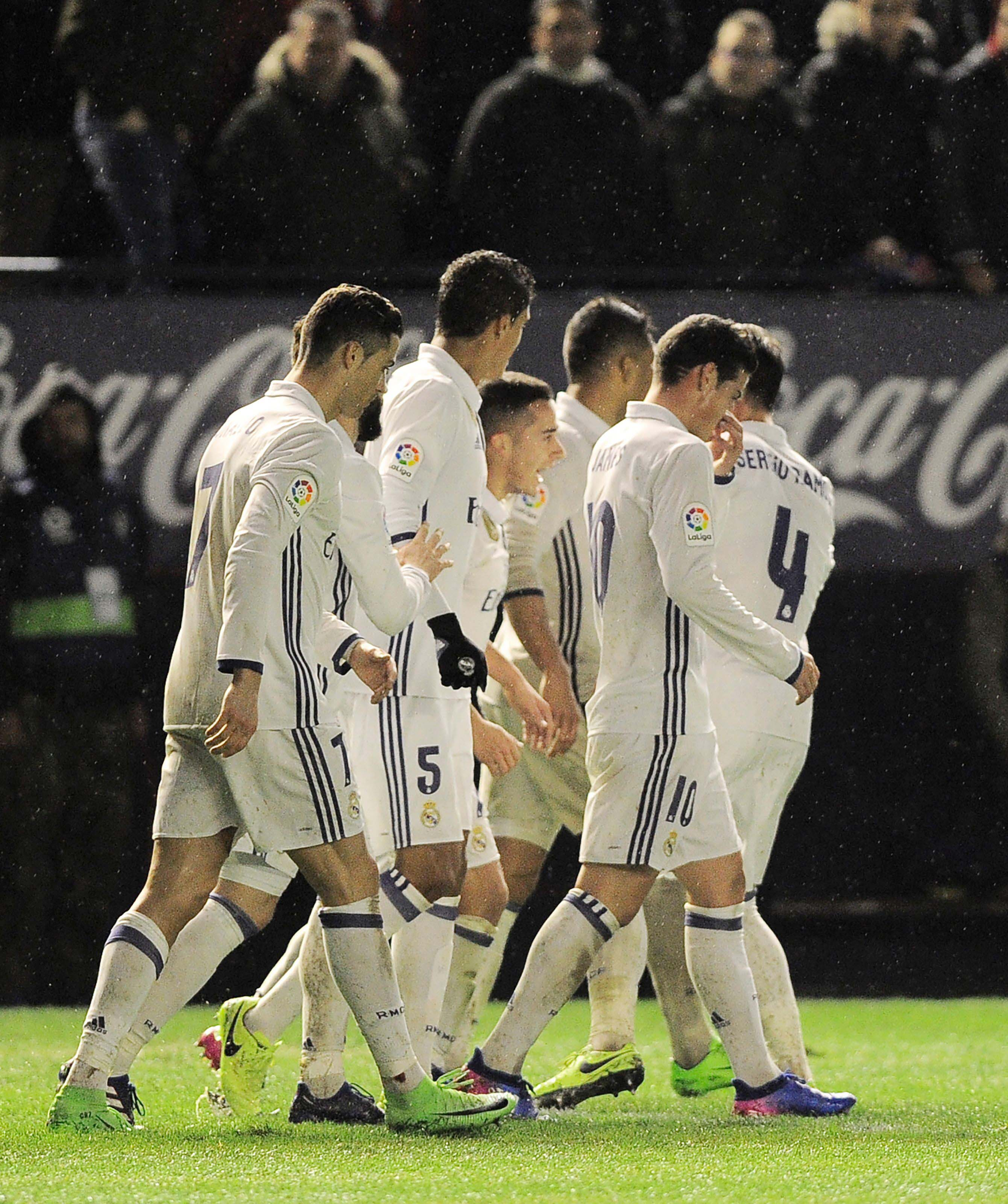 real were pushed to their very limits in their 3 1 win over osasuna despite it being the clash between la liga s top and bottom sides photo afp