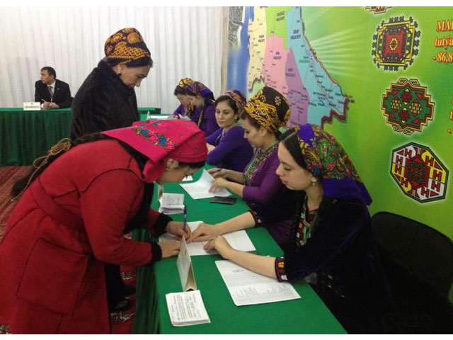 a woman signs to collect her ballot during a presidential election at a polling station in ashgabat turkmenistan february 12 2017 photo reuters