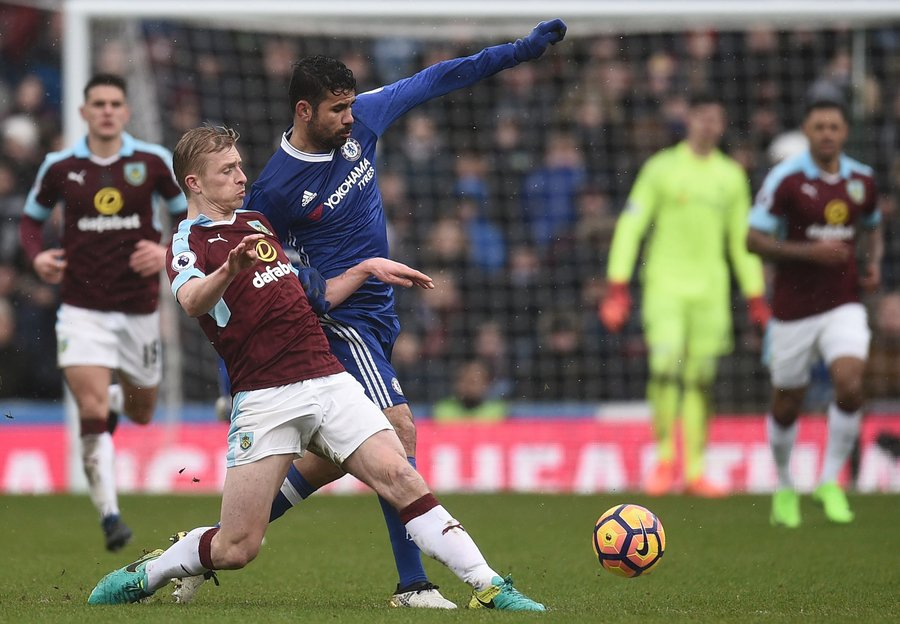 burnley 039 s english defender ben mee vies with chelsea 039 s brazilian born spanish striker diego costa 3rd l during the english premier league football match between burnley and chelsea at turf moor in burnley north west england on february 12 2017 photo afp
