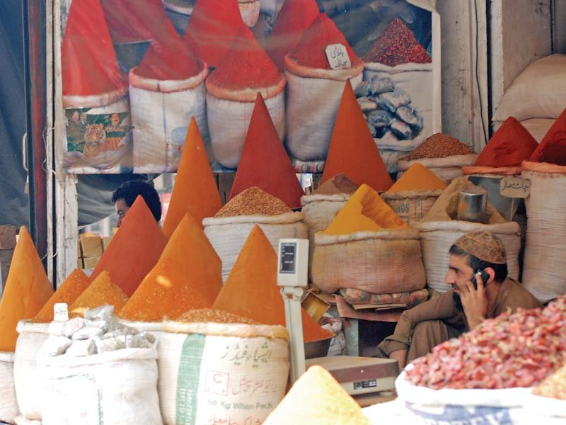 a shopkeeper sells unpacked spices at his shop in sargodha sale of loose food is a routine all over the country photo file