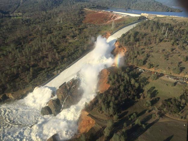 a damaged spillway with eroded hillside is seen in an aerial photo taken over the oroville dam in oroville california u s february 11 2017 photo california department of water resources william croyle handout via reuters
