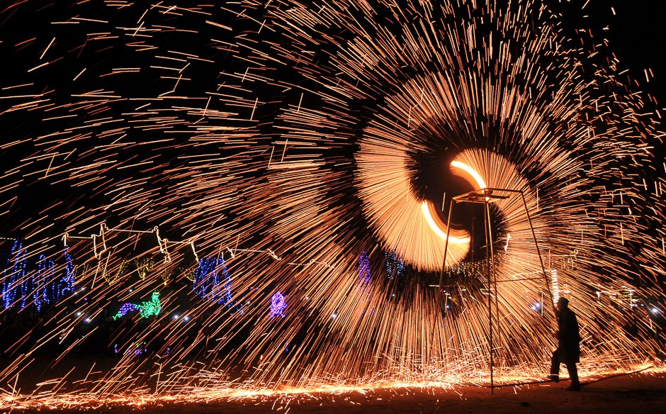 a folk artist performs the art of making shower of melted iron sparks at a celebrations event of lantern festival in anyang henan province china photo reuters