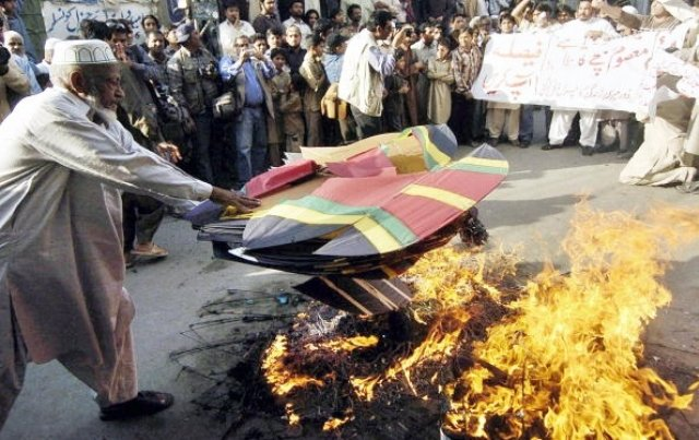 pakistani protesters burn kites during a protest against the use of metal strings in kite competitions photo getty
