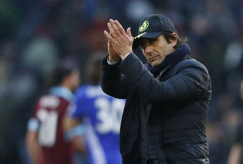 chelsea manager antonio conte applauds fans after the game against burnley on sunday photo reuters