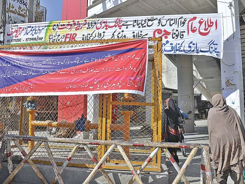 a banner by rawalpindi police warns against kite selling and flying photo app