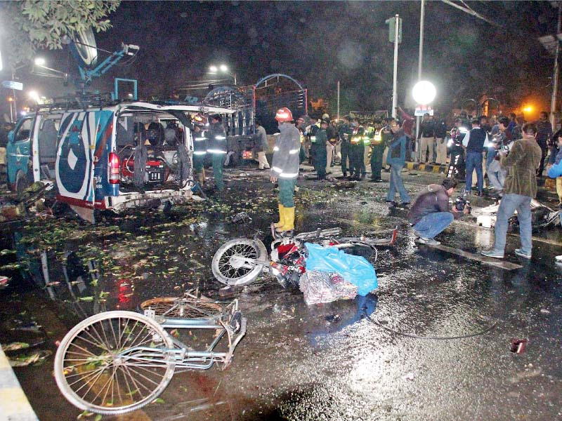 rescuers and police clear the site after the blast photo abid nawaz express