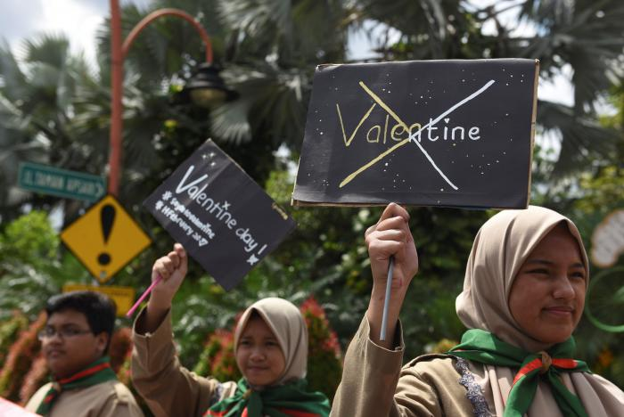 muslim students hold posters during a protest against valentine 039 s day celebrations in surabaya indonesia february 13 2017 photo reuters