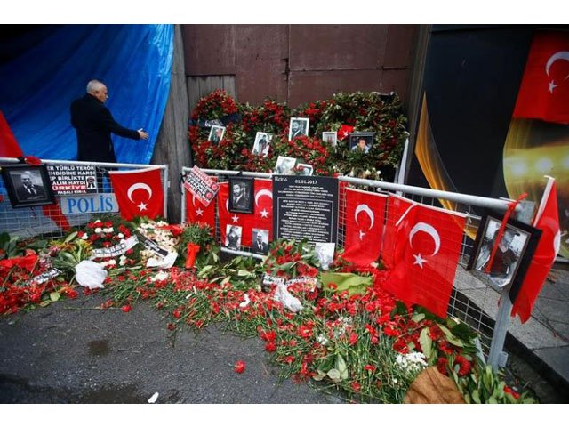 flowers and pictures of the victims are placed near the entrance of reina nightclub in istanbul turkey january 17 2017 photo reuters