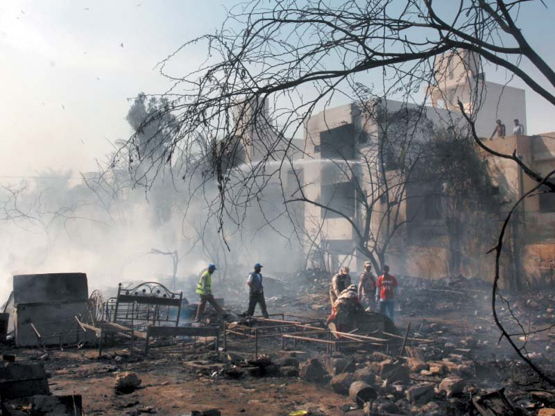 The blaze in Gulshan-e-Iqbal caused financial loss to the families living in the slums, with their valuables reduced to ashes. PHOTO: ATHAR KHAN/EXPRESS