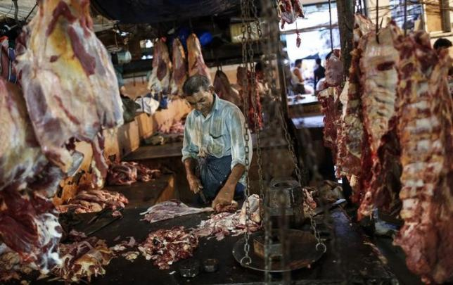 a butcher cuts up portions of beef for sale in an abattoir at a wholesale market in mumbai may 11 2014 photo reuters