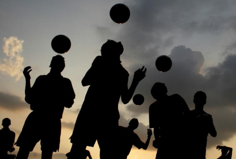 players from a soccer academy practice against the setting sun in the northern indian city of chandigarh august 30 2007 photo reuters
