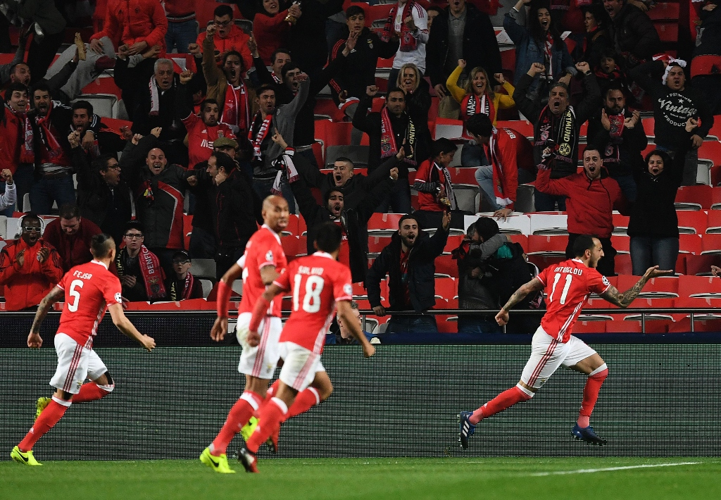 striker kostas mitroglou scored the only goal of the game as benfica go into last 16 s second leg with an advantage photo afp